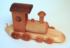 i have made these hard wood trains and other wooden toys since 1976