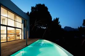 infinity pools for homes. Wonderful Pools The Curved Infinity Pool Extends From The Wooden Patio And Has Small Lights  Lining Straight Intended Infinity Pools For Homes I