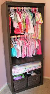 bookshelf repurposed as a diy nursery closet