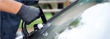 man installing new windshield