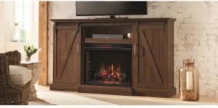 this chestnut hill media console with sliding barn doors and an infrared quartz electric fireplace was designed to add ambiance and warmth to your home
