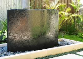 a small narrow backyard space was converted into a zen garden by transforming a stone sculpture into a water feature image deborah carl landscape design