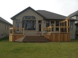 two tiered composite deck and privacy wall craftsman deck