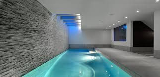 indoor swimming pool lighting.  Indoor Great Looking Indoor Swimming Pool Design With Grey Brick Wall And White  Ceiling Lighting Idea To L
