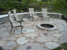 outdoor patio firepit raised limestone firepit irregular fond du lac limestone patio and seatwall surrounded by naturalistic plant materials outdoor paver