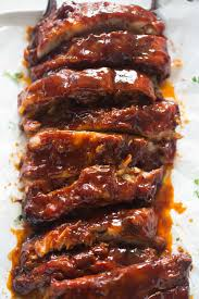 a large rack of ribs sliced and covered in bbq sauce