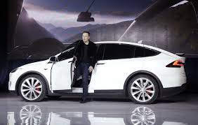 Musk challenges regulators to catch up to Tesla\u0027s driverless car ...
