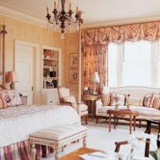 French Country Bedroom With Sitting Area