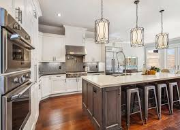 chandeliers have long been the light fixture of choice but unique pendants may give them