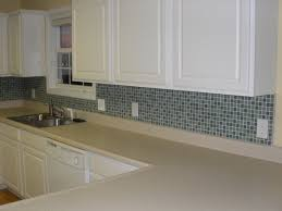 white kitchen with green subway glass tiled and black granite counter top with glass mosaic tile kitchen backsplash