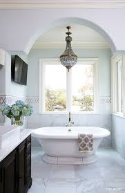 kohler vintage soaking tub with 19th c french empire crystal chandelier