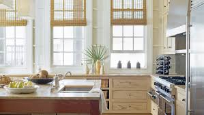 beach kitchen design. Bamboo Shades, Creamy Walls, Limestone Kitchen Countertops And Sandy Wooden Cabinets Create A Soft Beach Design