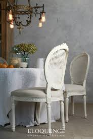 eloquence louis dining chair in a clic louis xvi style with slender tapered legs and a lovely oval backrest in antique white painted cane with fog linen