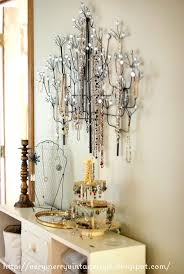 i ve been seeing metal wall art in the shape of trees and branches everywhere and i got the idea to re purpose one to display my jewelry  on home goods metal wall art with very merry vintage syle homegoods wall art turned jewelry tree