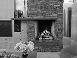 interior floating grey wooden fireplace mantels on tall grey stone fireplace near grey wooden cabinet