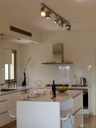 cool broan exhaust fans in kitchen modern with painted glass backsplash next to downdraft range vent alongside behind stove ideas and safe