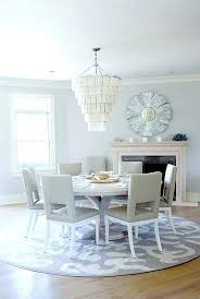 area rug under dining table or not rugs round room best picture photos on