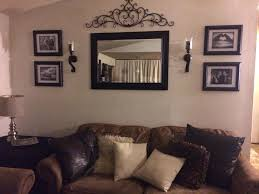 wall decorations for living rooms behind couch in room mirror frame sconces  and metal decor