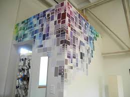 This modern + creative diy wall covering idea? Created with paint samples  (!)