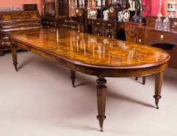 this is a stunning bespoke handmade victorian style extending burr walnut and marquetry dining table with