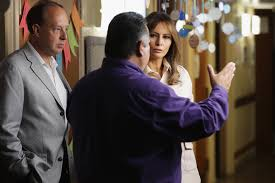 first lady melania trump walks through the facility with program director rogelio de la cerda jr after a round table discussion with doctors and social