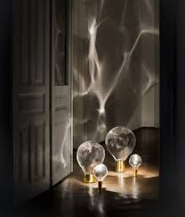 a lighting. ripple effect captured in glassdomed lighting by poetic lab a