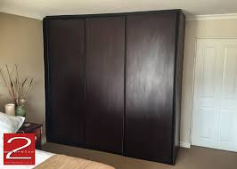 Attractive Bedroom Cupboard Sliding Doors In Burgundy Mahogany Finish With  Inspirations Of