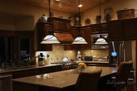 Kitchen Above Cabinet Decor Decor Above Kitchen Cabinets Dark Chimney Floating Cabinets Gold