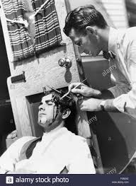 makeup artist ben nye painting blood on actor tyrone power ca 1940s he