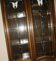 beautiful dark wood leaded glass and stained glass cabinet 4 doors 4 lights 4 glass shelves plus 2 wood shelves 81 1 2 inches tall 38 inches wide