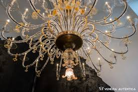 great gold and amber glass chandelier red in murano after it had been damaged in emilia