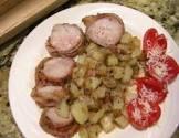 bacon wrapped pork tenderloin on the grill or broiler