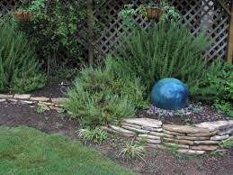 add focal point to hide backyard vegetable garden