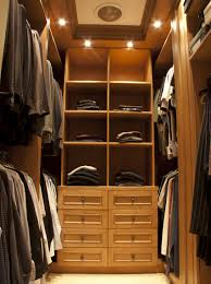 walk in closet with suits for a man
