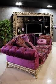 Beautiful purple sofa in a modern apartment