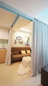 tiny apartment singapore living area curtains