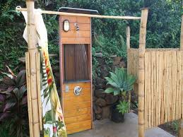 bamboo outdoor shower stall with wooden space for metal and