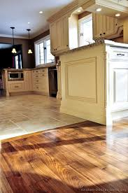 kitchen idea of the day perfectly smooth transition from hardwood flooring to tile floors in an open plan kitchen things to show brian