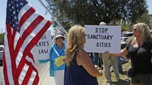 Gray But Crackdown Immigration Label Areas Trump Promises Has Donald Npr 'sanctuary City'