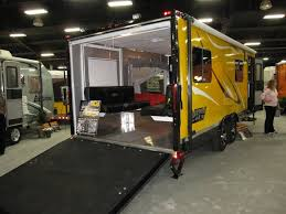 the rear entry vrv toy hauler at the rvia exposition the color of the vrv rigs in the exhibit suggests action and adventure