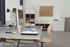 pictures of an office. office worktable with desktop computer cup of coffee notes and gadgets inside an pictures r