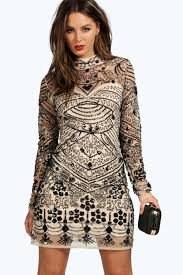 Mandy Moore rocks curly hair and plunging black velvet dress.