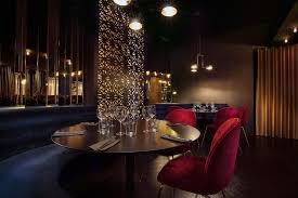 our neiva chandelier creates a striking centre piece in this restaurant lighting project