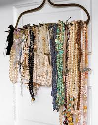this necklace organization idea. Use an old rake to hang your necklaces!  Hang it in a closet, on the back of a door, on a regular wall as art work.