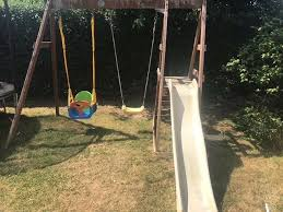 wooden double swing set with slide multi stage swing seat