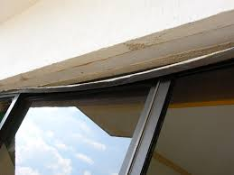 a track anchorage failure for a set of sliding glass doors note the single fastener hole above the door panel