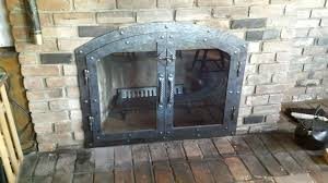 fireplaces accesories brick wall fireplace mantel black metal with glass fireplace door brick floor black