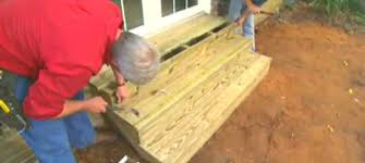 How to build a deck video Concrete Patio Eyedrop How To Build Exterior Wood Steps Todays Homeowner