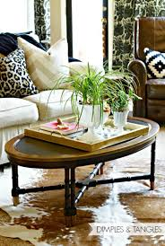 as i ve been refreshing my breakfast nook i ve thought all along how great a hide rug would look layered over my natural rug under the table