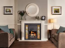 stovax art nouveau tiled convector fireplace in matt black with blue iris tile sets shown with georgina roundel stone mantel in antique white marble